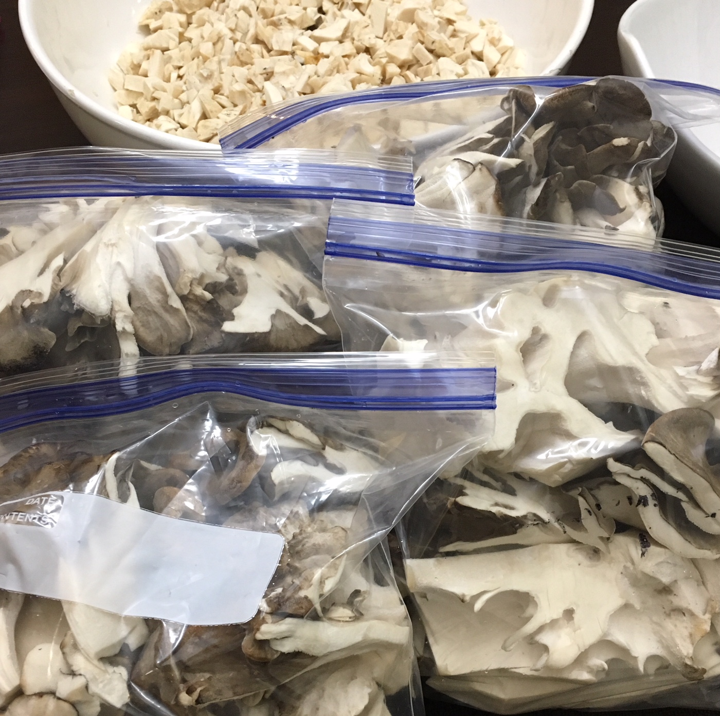 Chopped maitake mushrooms in freezer bags ready for longterm storage.